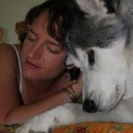 This picture is of Juliet Rosenthal, owner of Boulder Pet Care, and a husky named Hudson.